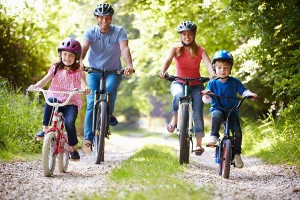 bigstock-Family-On-Cycle-Ride-In-Countr-55016255